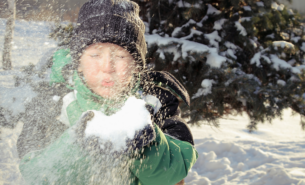 Boy Blowing Snow.png