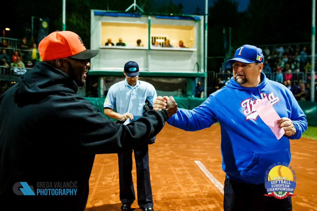 Championship coaches shake hands before the matchup begins.