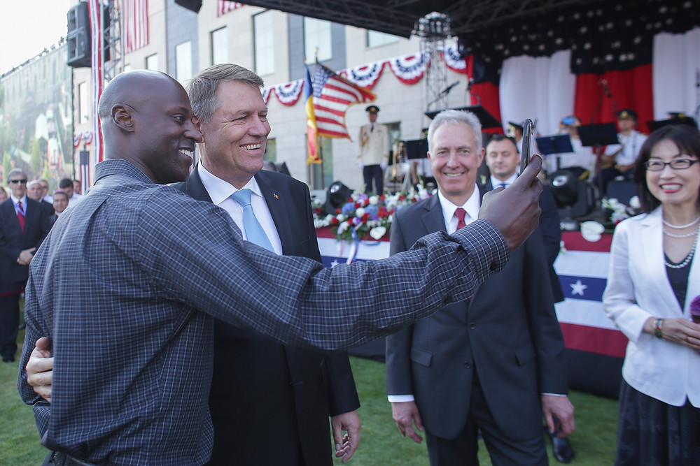 Hawkins and President Iohannis snapping a selfie on 'Ebbets Field'