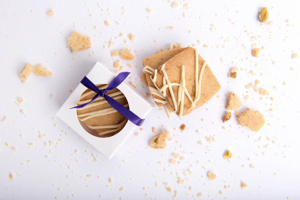 Sweet cookies of various flavours for wedding favours by velvetier brisbane bomboniere