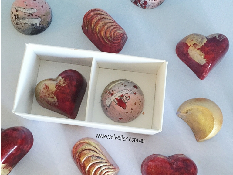 Red pink gold and white custom chocolates Brisbane Velvetier
