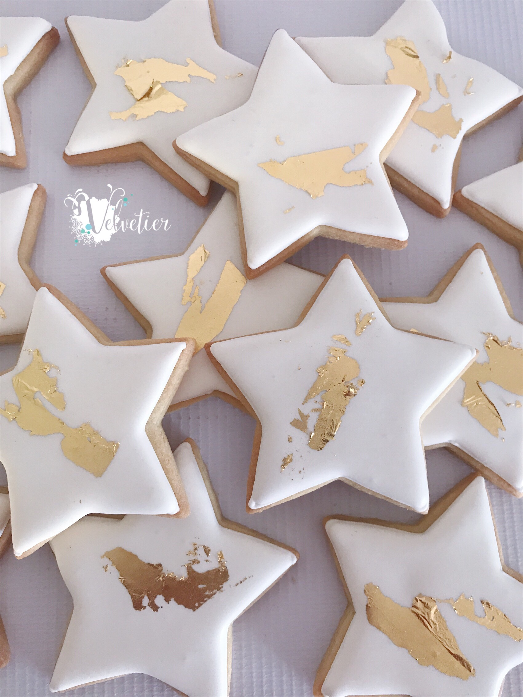 White and gold star cookies by velvetier brisbane