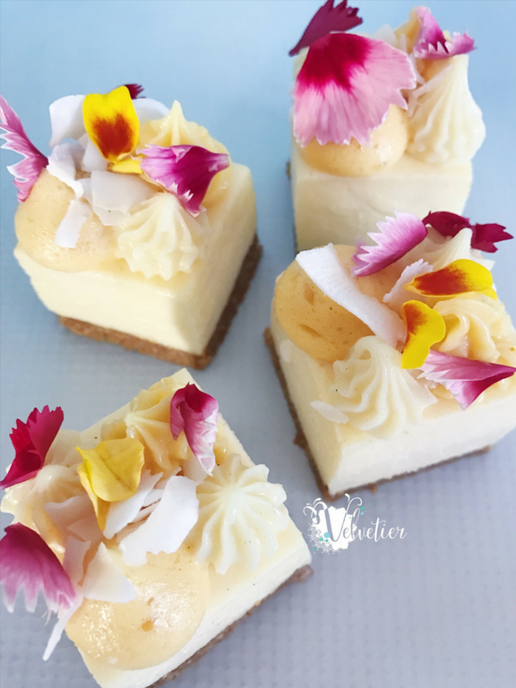Passionfruit and coconut loaded cheesecake with edible flowers by velvetier brisbane