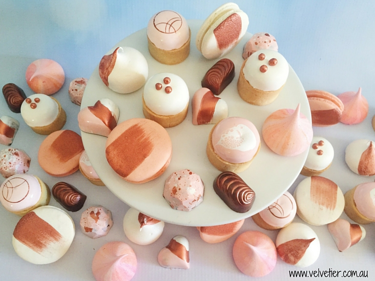 Peach pink copper and white selection of tarts chocolates macarons and meringues Velvetier Brisbane