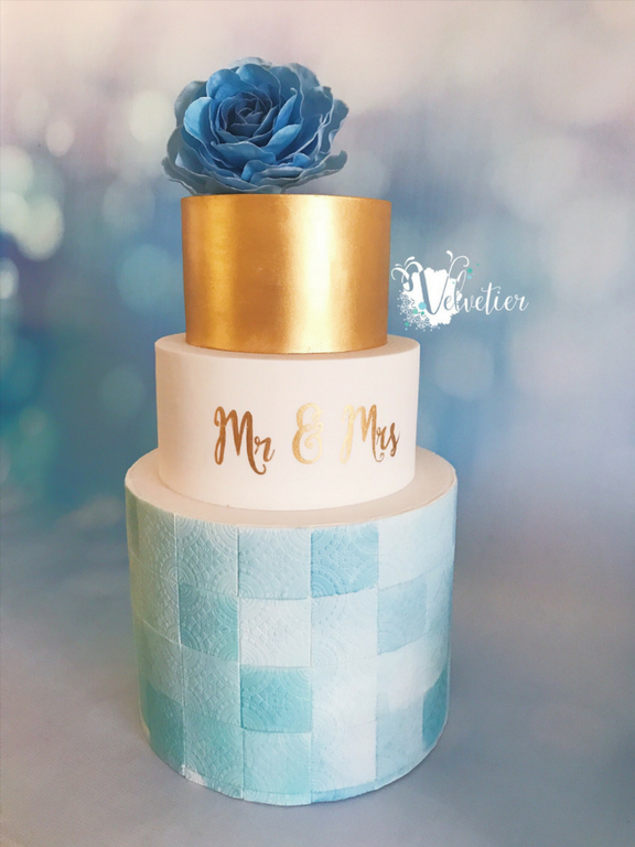 Blue watercolour tile and gold wedding cake with monogram and wafer paper flowers cake by Velvetier