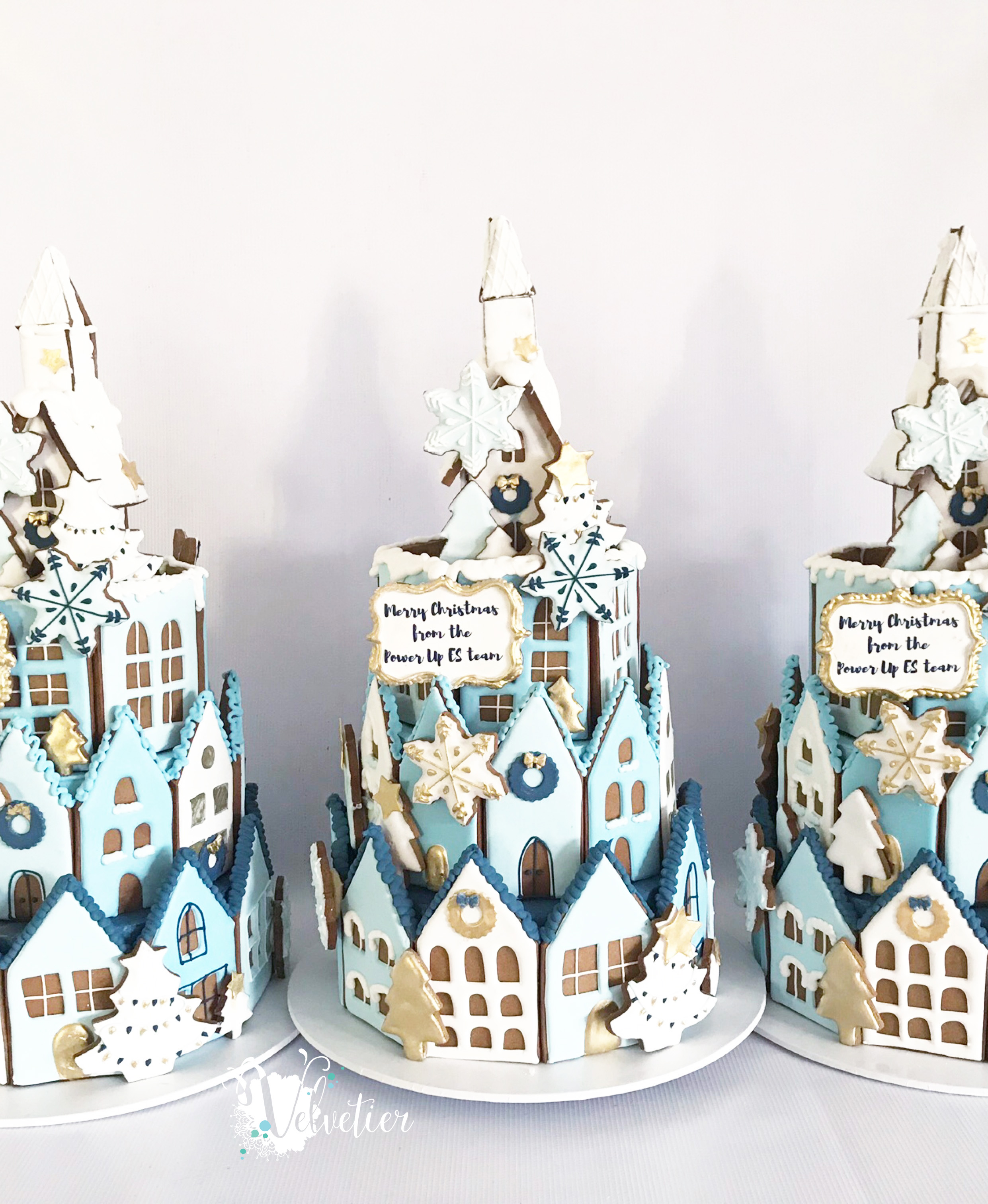 Tiered gingerbread houses in brand colours for corporate gifts by Velvetier Brisbane