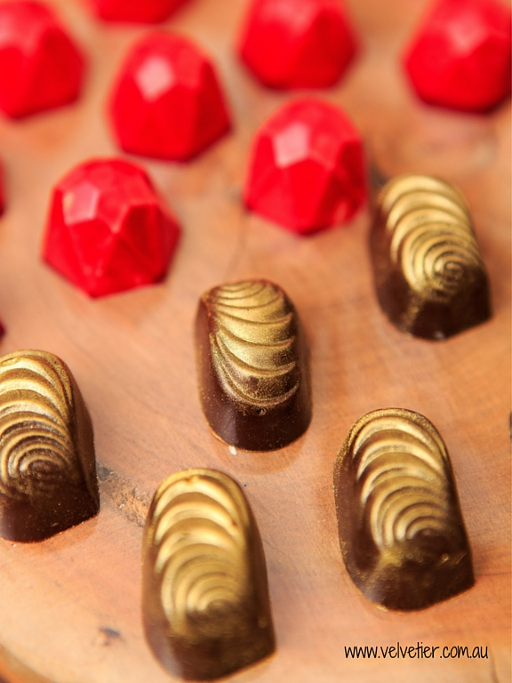 Red gem and gold swirl custom chocolates Velvetier Brisbane