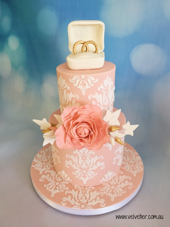 Peach and white stencil cake with ring topper and sugar flowers by Velvetier Brisbane Cake