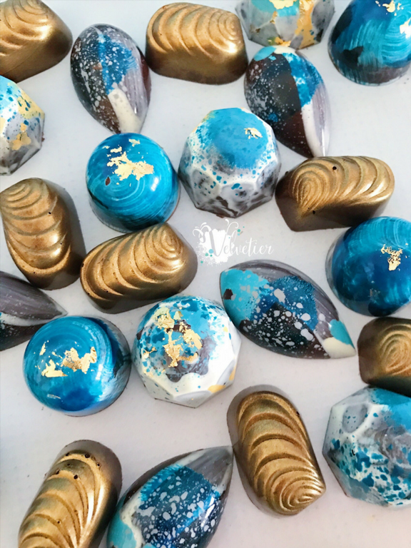 Shades of blue white and gold bonbons by velvetier brisbane chocolatier