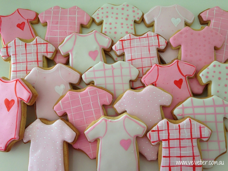 Pink and white baby onsie cookies Velvetier custom cookies Brisbane