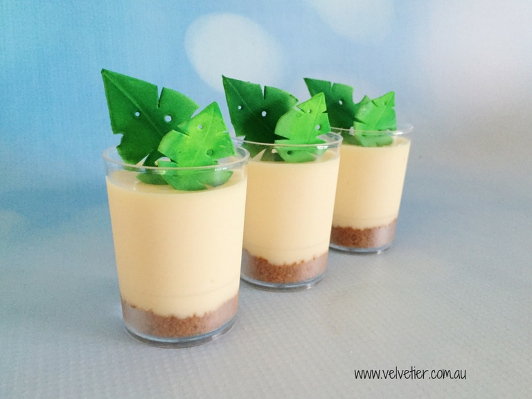 Lemon cheesecake with tropical leaf decoration by Velvetier Brisbane desserts