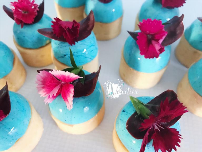 Aqua blue double decker tarts with edible flowers by velvetier brisbane desserts