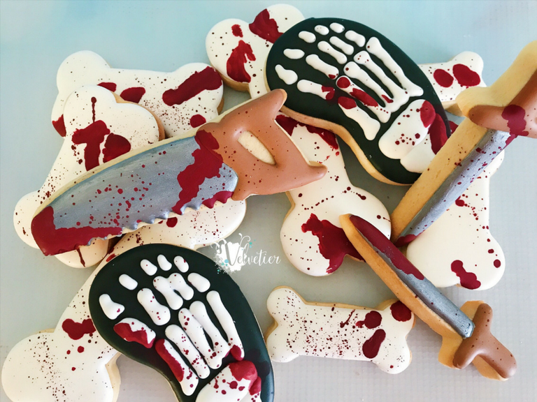 saw skeleton foot dagger and bloody bone halloween cookies by velvetier brisbane
