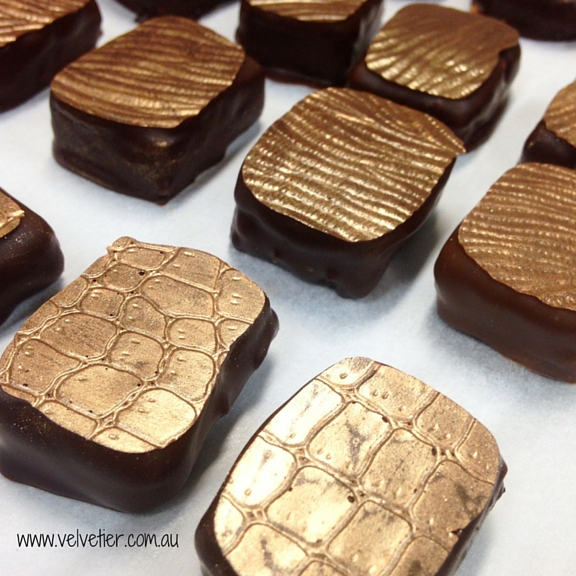 Gold patterned hand dipped praline Velvetier custom chocolates Brisbane