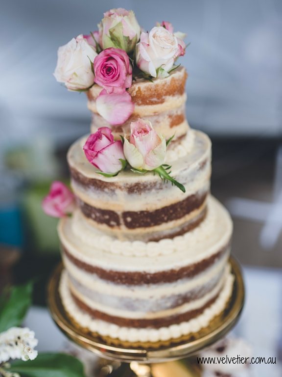 Semi naked wedding cake with fresh roses Velvetier Brisbane