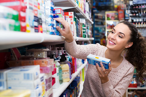 Positive female buying toothpaste for se