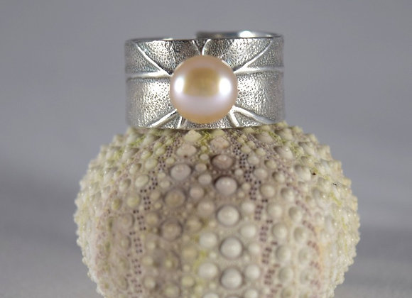 Drop of pearl in the sea ring
