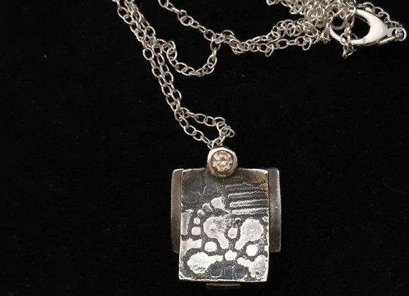 Shinto curve reversible necklace