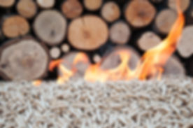 Burning Oak pellets in front a pile of woods.jpg