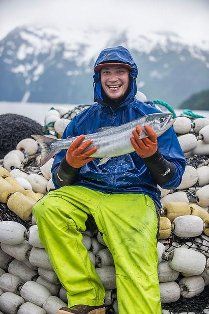 Fisherman-Holding-Salmon-972-600x800.jpg