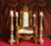 Royal throne of gold on red curtain back
