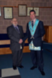 Worshipful Master Stephen Bell welcoming Bro. Hugh Blair to Abbey 180