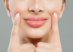 """The Restylane family of fillers can be utilized in a variety of applications to enhance volume loss in the face, lips and hands. We carry Lyft, Defyne, Refyne and Kysse.  We primarily use Revanesse Versa for lip augmentation and tear troughs. It is also a wonderful product for smoothing fine lines and wrinkles in the face. Versa is """"versatile"""" and can be used in many ways. Belotero is another soft filler with diverse applications for the face. We use hyperdilute Radiesse, which is a calcium-based filler to promote biostimulation. Please make an appointment for a consultation to see which filler will best suit your needs."""