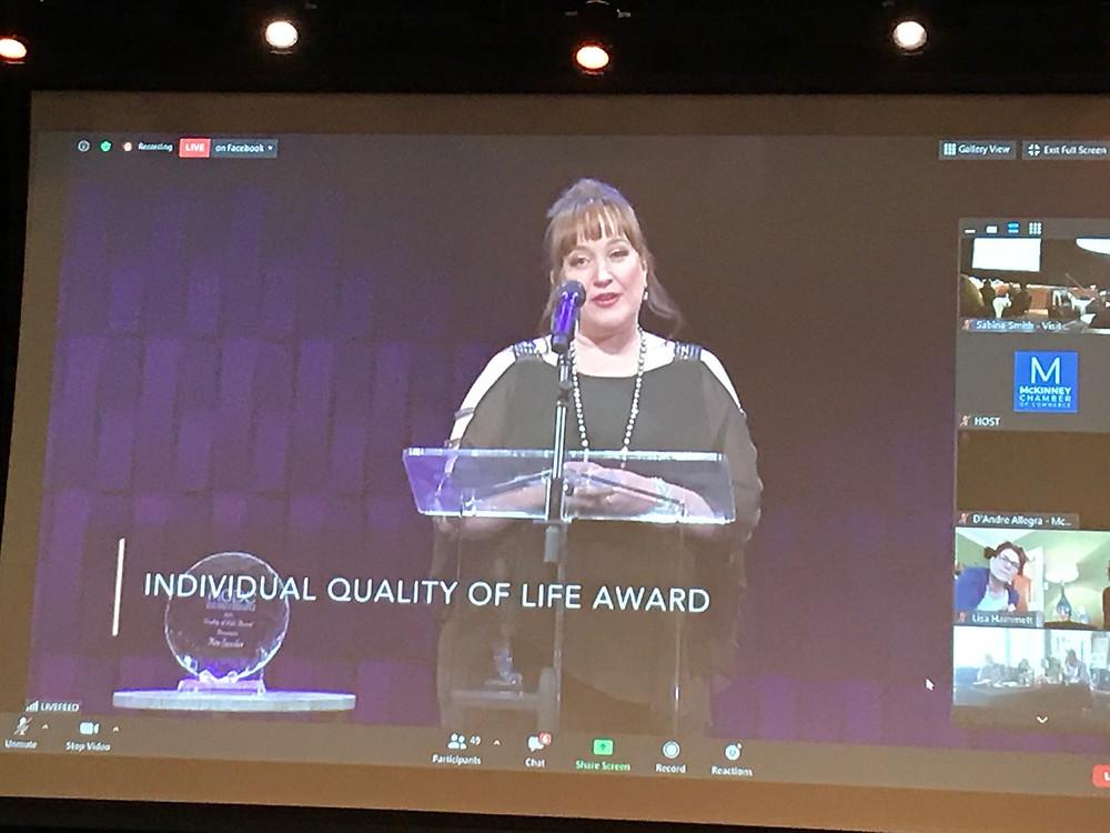Kim Sanchez accepts the 2021 Quality of Life Award