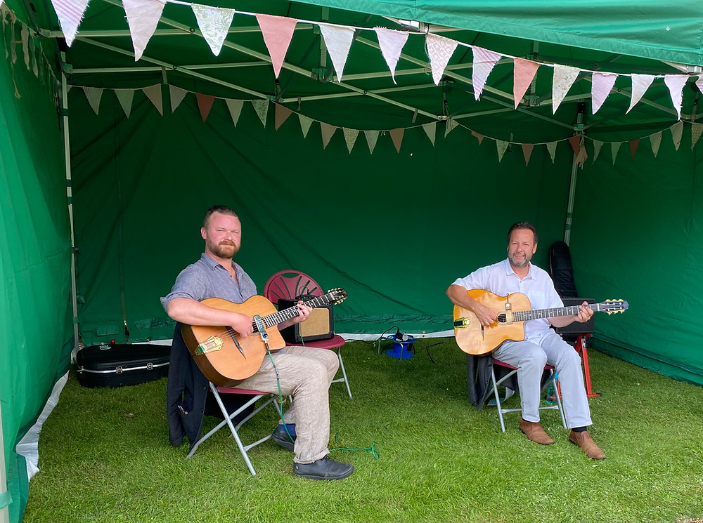 Jonny Hepbir Gypsy Jazz Duo at Haseley Court Summer Garden Party, Little Haseley in Oxfordshire. Hire The Jonny Hepbir Gypsy Jazz Guitar Duo for a Wedding, Party or any type of Event.