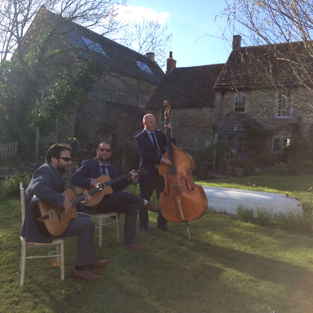 Jonny Hepbir Gypsy Jazz Trio Playing A Wedding At Stowford Manor Farm In Wiltshire
