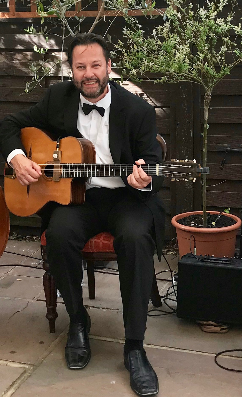 Jonny Hepbir Solo Gypsy Jazz Guitarist Performing For A Corporate Event At Wimbledon