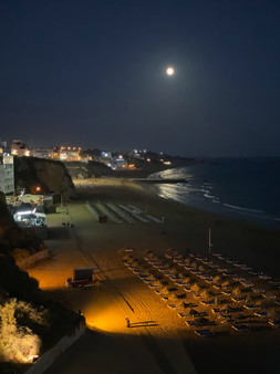Moon over the Albufeira town beach