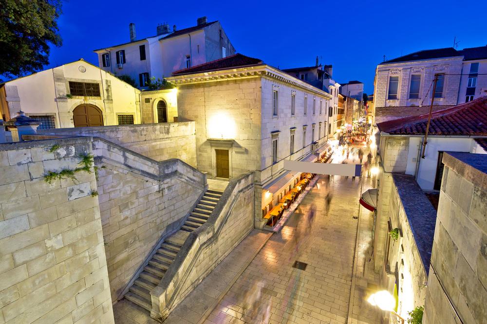 Historic stone street of Zadar evening v