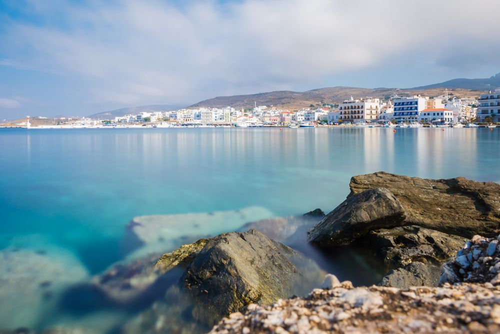 Tinos-city-and-harbor-in-Cyclades-agains