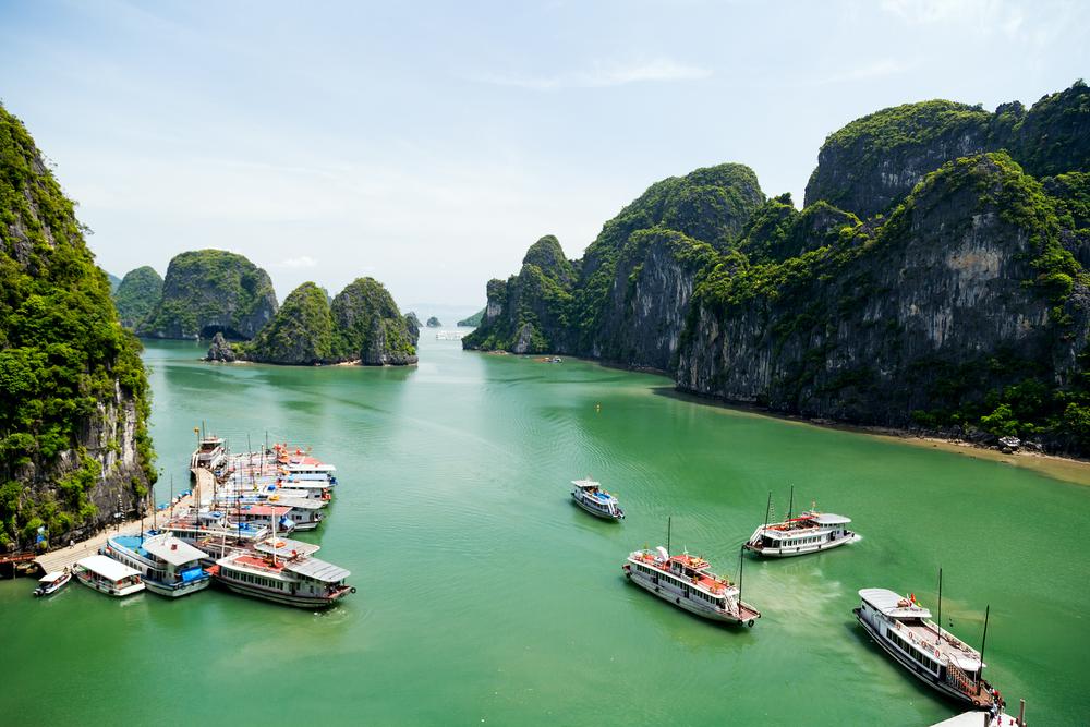 Tourist junks floating among limestone r