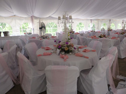 Pink and white with chair covers