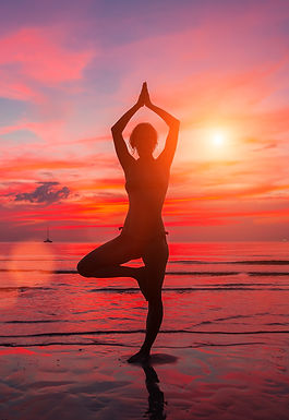 Meditation girl on the sea during sunset