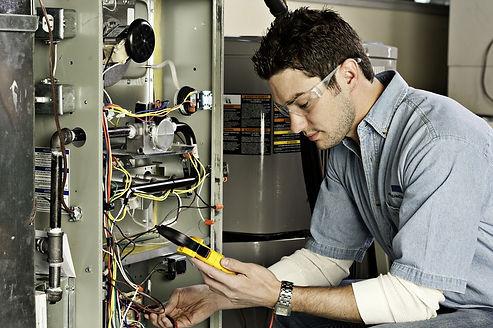service-technician-testing-furnace.jpg