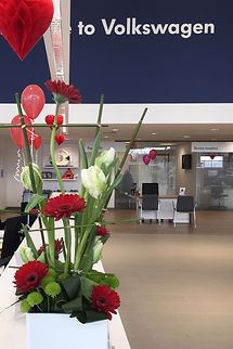 red gerbera, white tulips, bamboo, twisted leaves