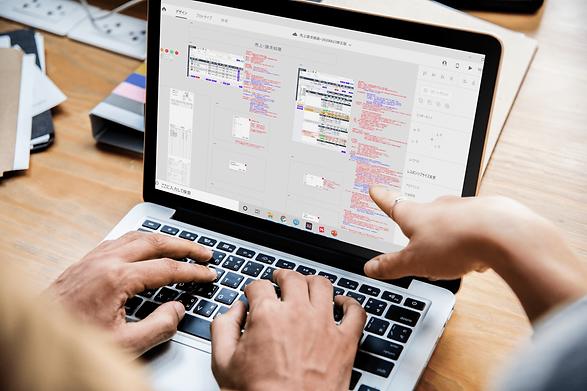 414403 People working on MacBook Pro.png