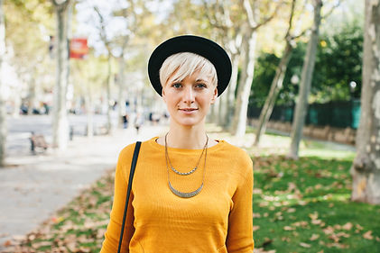 girl with pixie yellow sweater