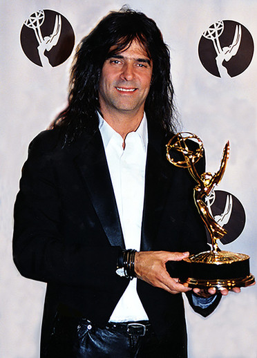 Mark with his Emmy award