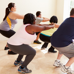 Fitness Instructor In Exercise Class For