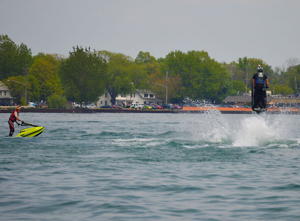 Crazy Joe and a customer ride their BAM Hulls on lake st clair