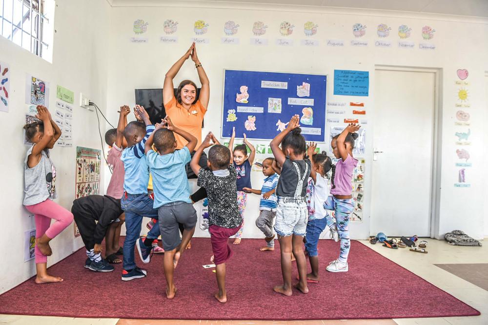 Volunteer Hana Eder from Germany, practising yoga with the children.