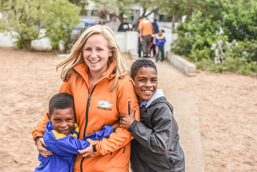 Caro Zobel, a volunteer, with Audriek Snyders and Roewaan Kruger from Paternoster