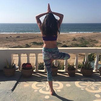 Vrkshasana overlooking ocean in Morocco.