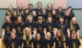 Team photo in black show shirts.jpg