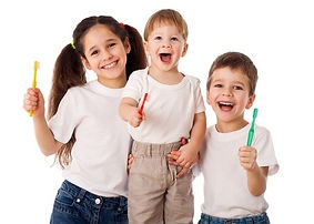 Happy kids brushing teeth