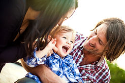 Young family with laughing child
